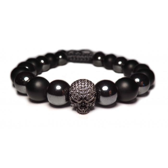 Le bracelet perles hematites et tete de mort argent