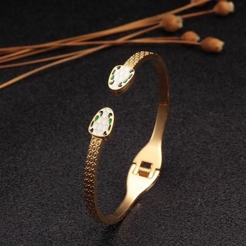 bracelet manchette femme tete de serpent
