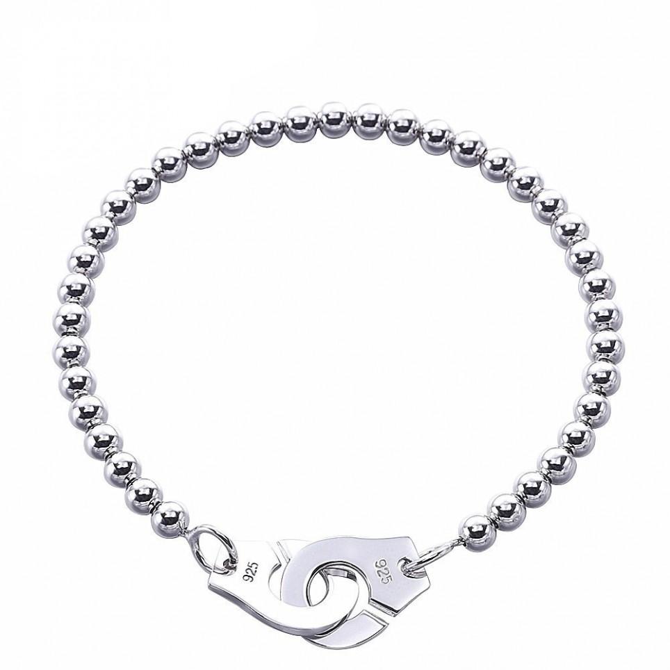 bracelet perles et fermoir menottes femme