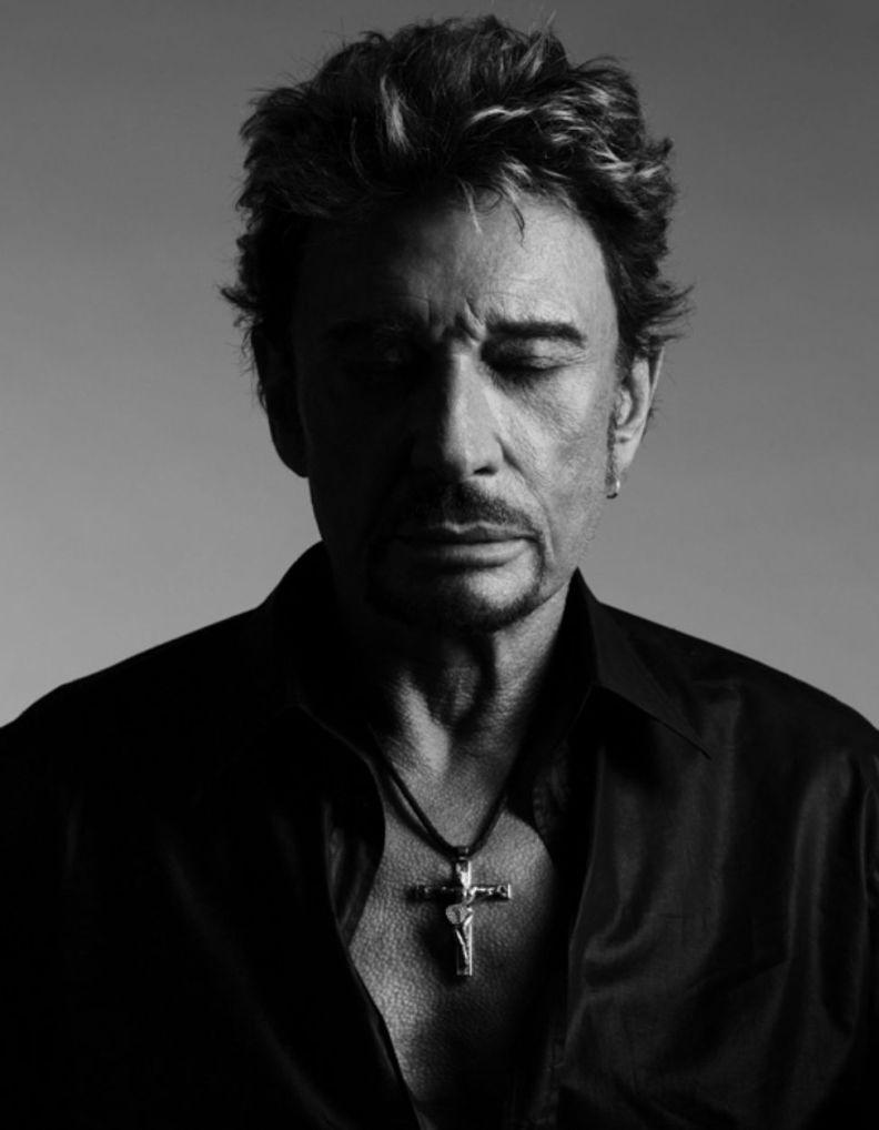 photo of johnny hallyday with a cross